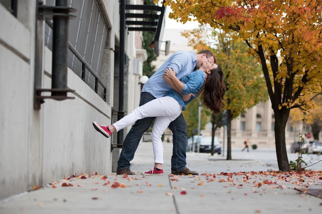 a couple kissing in fall
