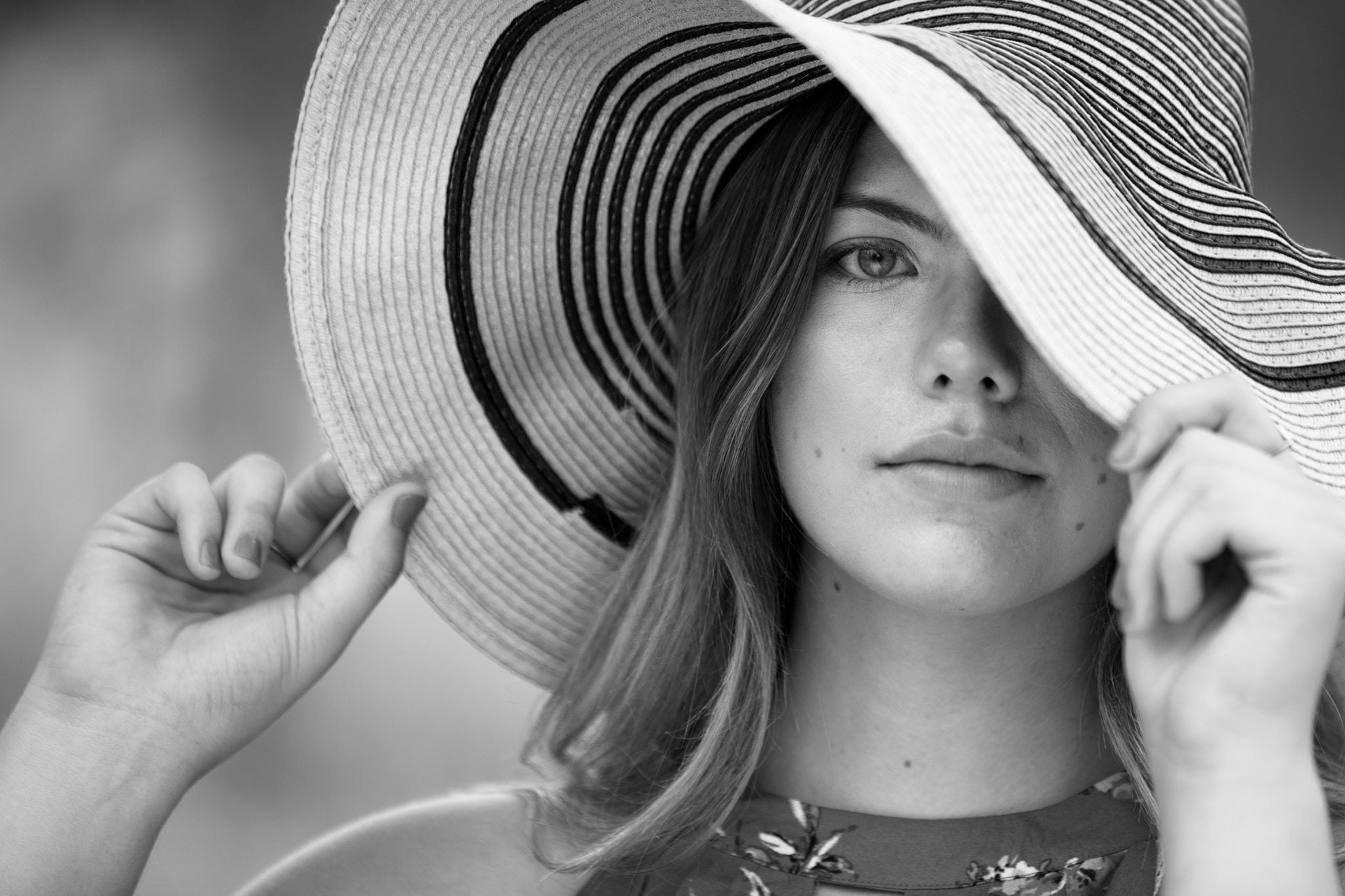 Senior photo of girl with hat